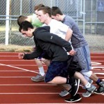 High jumpers and long jumpers get warmed up by taking several laps around the track.