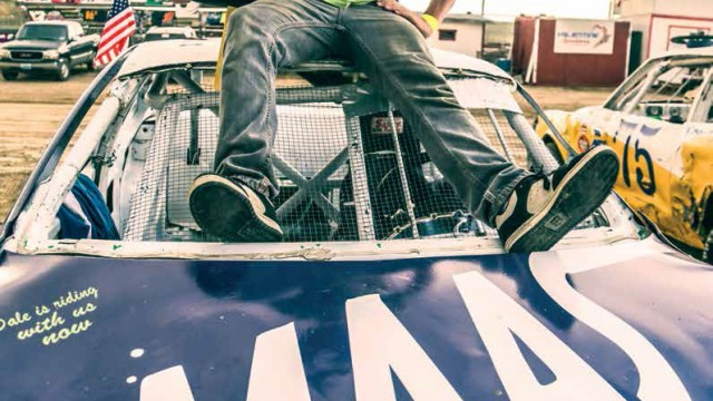 Adrian Maas sits atop his own race car that he has been driving since before he could legal drive on the streets.