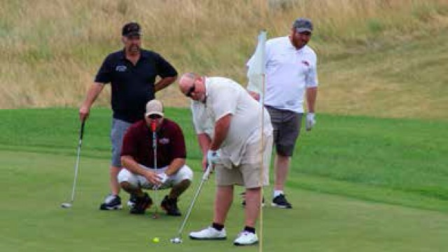 Golfers finish their putts on the last hole of the Fore the Kids Golf Tournament July 29 at the Glenrock Golf Course.