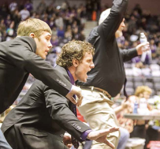 Jackson Taylor (from left), coach Nic Dillon and coach Don Flynn intently watch and cheer as Jaden Williams wins his first state title and the first GHS heavyweight title.